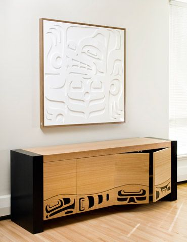 """Feast Sideboard - WhaleInspired by the traditional Northwest Coast feast bowl with its undulating rim, the distinct door widths reflect the combined four sides of a feast bowl in elevation. The whale motif is cut through the oak revealing a 1/8"""" depth highlighted by an ebonized oak backing. Edition 10."""