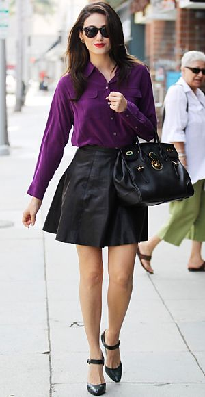 Leather  The Look: The edgy material can make an appearance on the office floor when paired with the right pieces.  The Key: The clean lines of a bright button-down add just the right amount of polish to a full or pencil skirt.