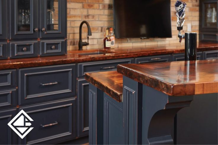 Gorgeous colour cabinetry with a beautiful wooden counter top. Love the breakfast bar top island. Great for a party with lots of friends and family.