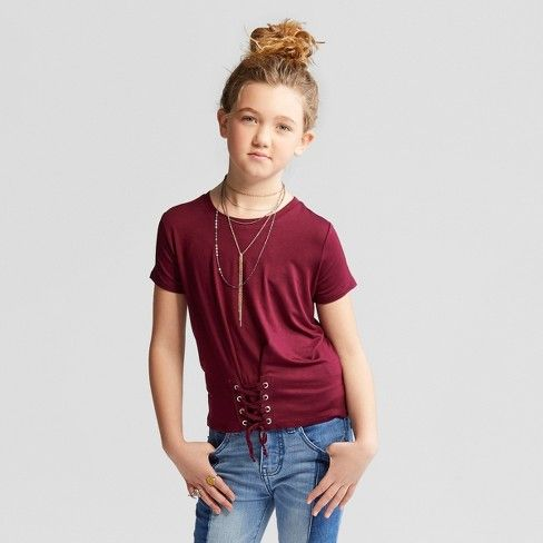 Your fashion-forward girl will love changing up her casual looks with the Short-Sleeve Corset T-Shirt from art class™. This girls' short-sleeve T-shirt is decorated with a lace-up detail on the front hem, letting her customize her look every time she puts it on. Whether she pairs it with a skater skirt and ankle boots or jeans and flats, she'll love making a look that's all her own.