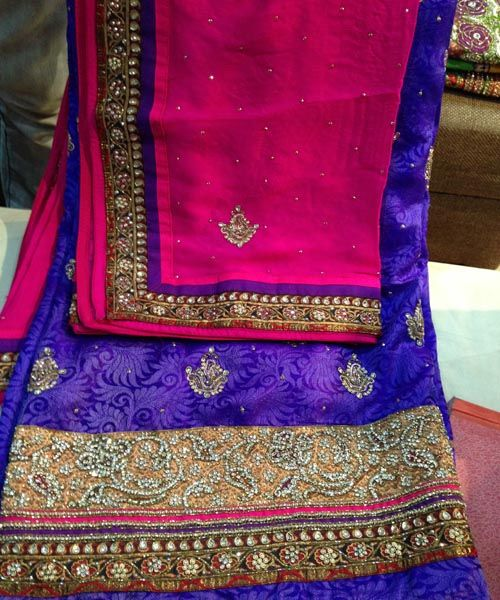 Love the embroidery. Pink and blue embriodered punjabi suit.