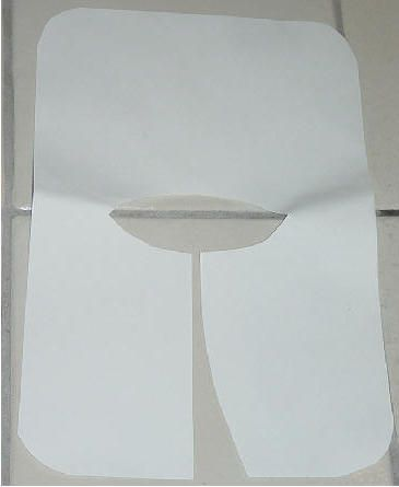 Child's Pilgrim Collar. Round the corners of a 12x18 piece of white construction paper. Make a slit in the center front. Cut a neck hole in the center to fit. Slip over head.