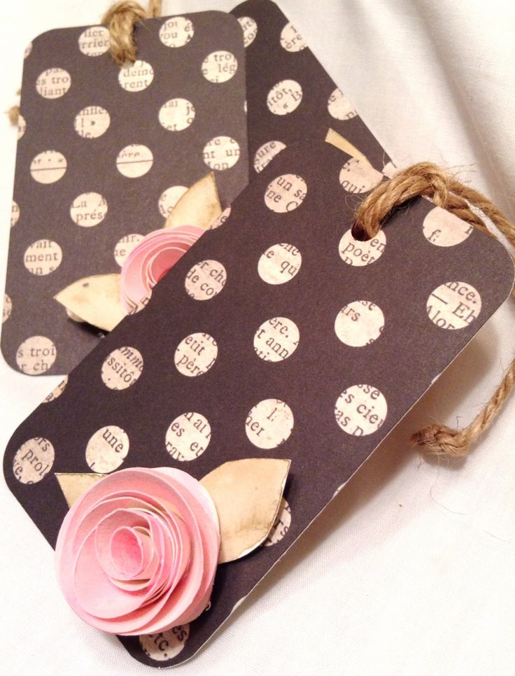 Set of three gift tags. Polka dot card stock paper, Eachh is adorned with hand made, hand painted roses with leaves. Each corner is hand punched to finish the look. The ties are made from high quality