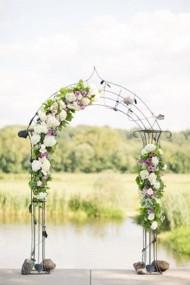 floral altar arch at outdoor ceremony at a Barn wedding at Riverside on the Potomac by Katelyn James Photography