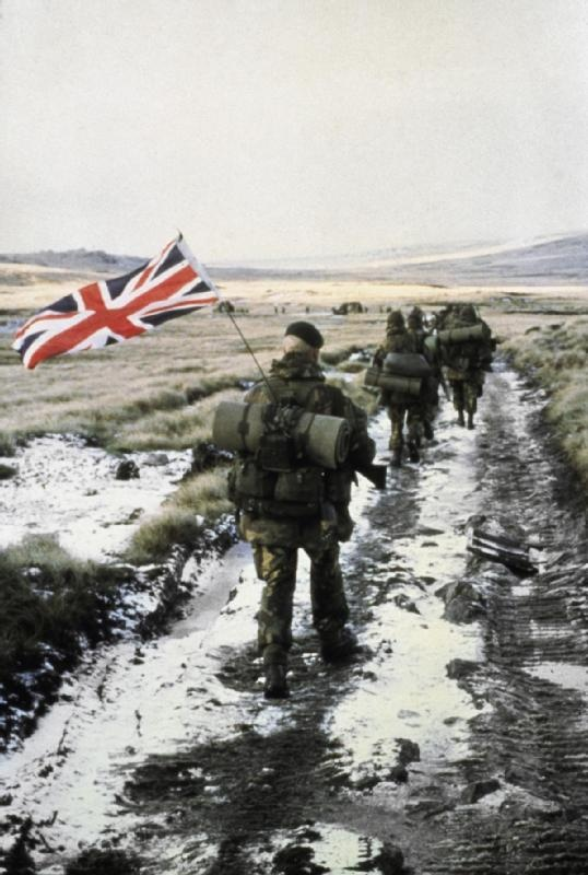 Commandos marching towards Port Stanley  FKD 2028    A column of 45 Royal Marine Commandos marching towards Port Stanley, June 1982. By early afternoon on 14 June 1982, the Royal Marines of 3 Commando Brigade reached Stanley. After a few hours' negotiation, at 9pm General Menendez, the Argentinian Governor, surrendered to Major-General Jeremy Moore, the British Land Force Commander.