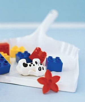 Dustpan as Toy Herder - Scoop up small toys―Lego blocks, jacks, Barbie shoes, plastic soldiers—with your dustpan and brush, so you can reclaim your living room for grown-ups.    I've been known to do this!  LOL