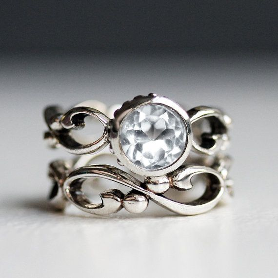 A 7mm white topaz sparkles in the sterling setting I hand carved to have a subtle infinity symbol pattern all around. My inspiration for carving this