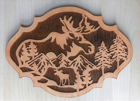 This moose nature scene is a wooden plaque to hang on your wall.  Get just this one for $40 or get a set of three for $100.