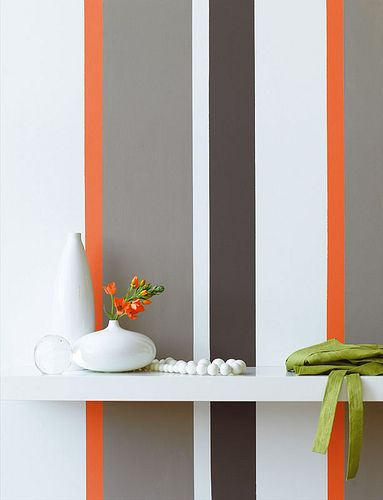 Grey and orange striped wall by The Little Greene Paint Company, via Flickr  Love the multi color vertical stripes...pink, blue, green for K's room?