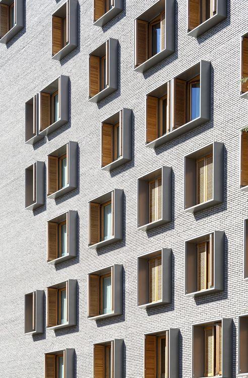 dezeen:  Michel Guthmann pairs grey brick with larchfor Paris...