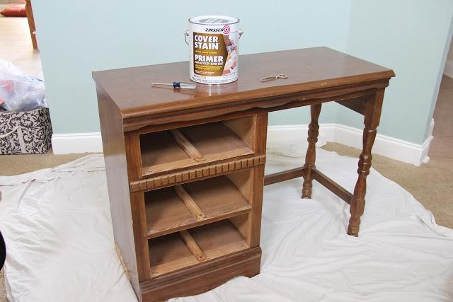 Painting laminate furniture -- grotty bookshelves beware.