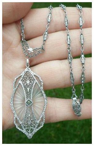 Antique Art Deco rhodium filigree and camphor glass necklace.
