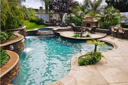 the rich aqua of the pool and the multi layered curves bring just the right tropical touch to this landscape designed by oakbrook landscape inc - Swimming Pool And Landscape Designs