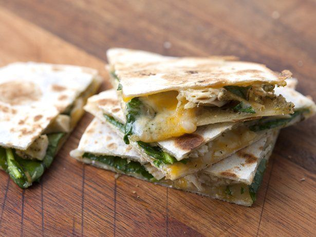 Prepared pesto is a perfect way to upgrade any meal, including (who knew?) quesadillas. These filled flour tortillas are so simple to make, and it's easy to pack in the vitamins by adding in spinach. Make them in a sandwich maker, griddle, cast-iron skillet or panini press.