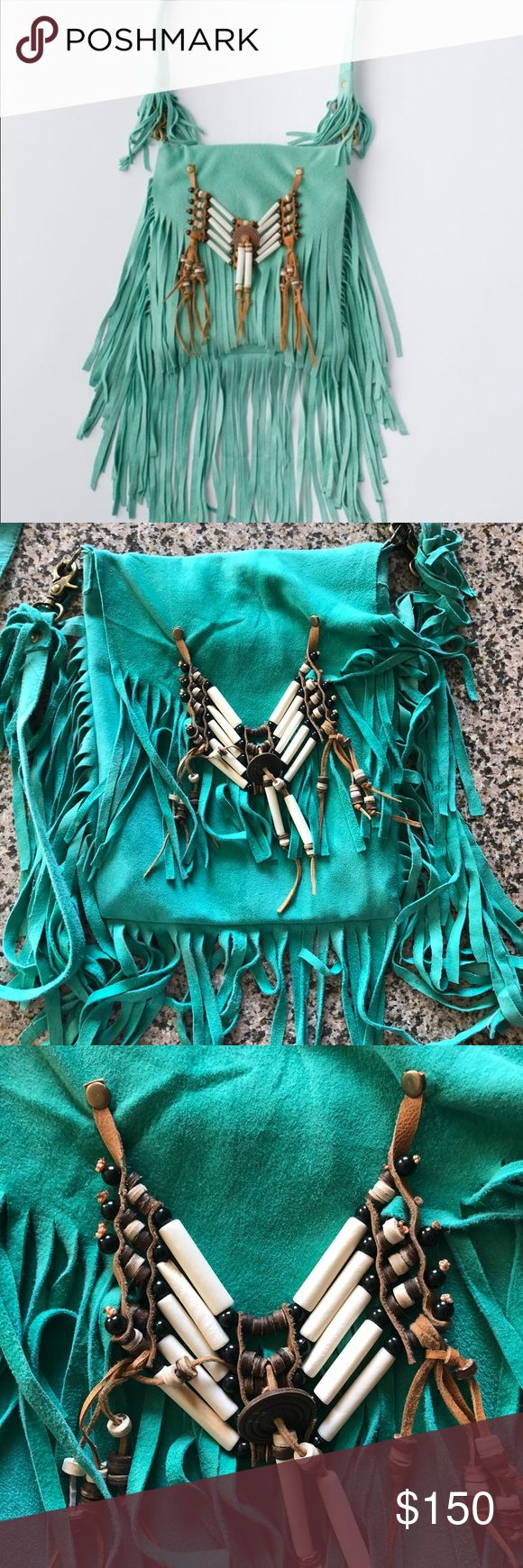 Spell turquoise bone tassel bag Used one time. All I could find was a few transfer spots on the back of bag(last photo) front and inside is in great shape. Size is about as tall as a business envelope (as pictured) so soft! Cross body strap. Will only trade for other Spell.   🦄 unicorn I'd swap full or partial for: Amber babushka Forever lovers tee small-XL Xanadu maxi Folktown blossom  Jagger  Vintage tees tanks (Spell) Saphari  Kimonos (kombi, creamGQ, jagger,babushka) Video all…