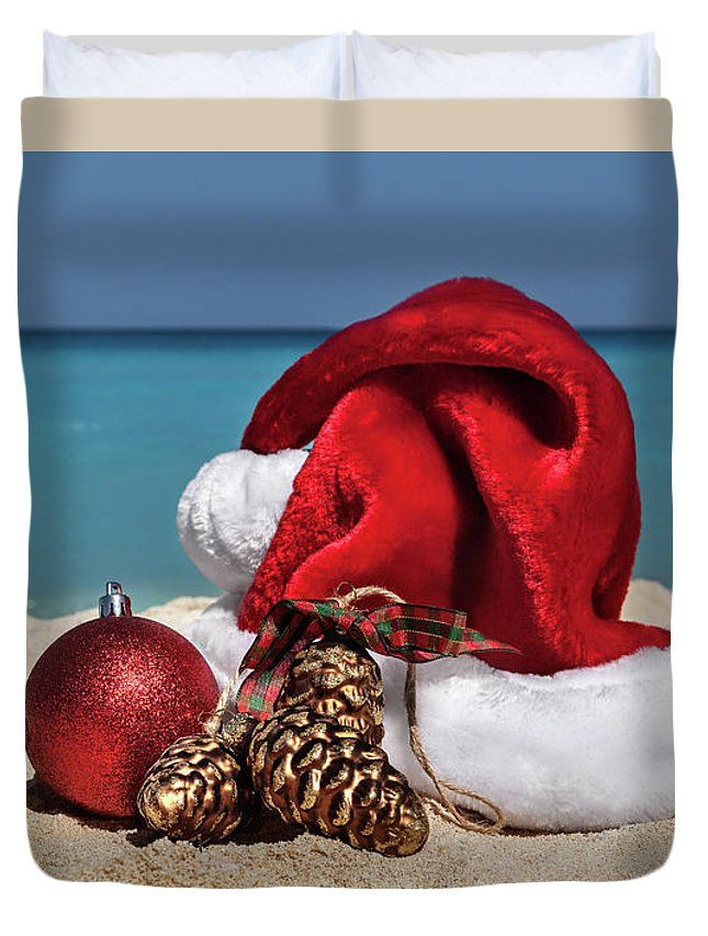Duvet Cover featuring the photograph Christmas Hat by Evgeniya Lystsova. Santa Claus Hat and Christmas decorations at the sandy tropical beach, holiday concept. Make your Home Special with Stylish Art Products you choose! Our soft microfiber duvet covers are hand sewn and include a hidden zipper for easy washing and assembly. Your selected image is printed on the top surface with a soft white surface underneath. #DuvetCover #Christmas #Beach #SantaHat  #Decorations #HomeDecor #Gifts #Bedroom