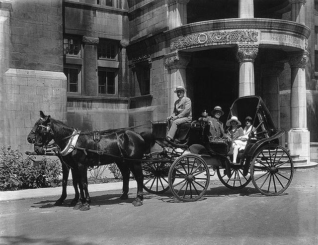 Carriage with unidentiCarriage with unidentified people, MacDonald Physics Building, Montreal, QC, 1928, via Flickr.