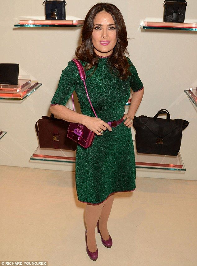 Green with envy: Salma, 48, looked simply stunning in her forest green sparkly dress...