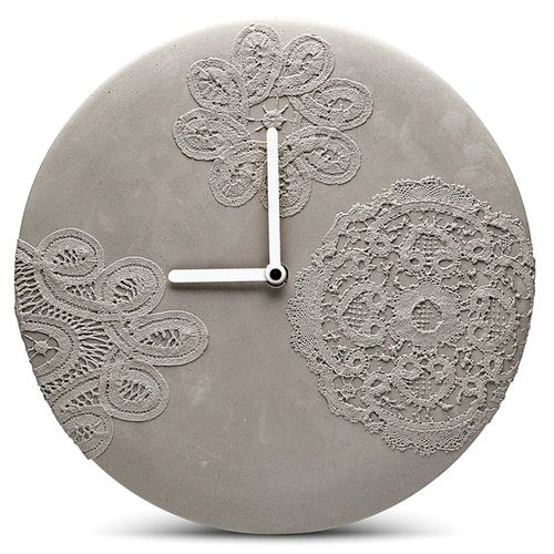 'concrete wall clock with lace pattern' by mensch made from the netherlands