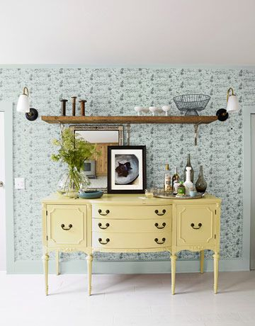 Wallpaper works wonders to soften a dining room, especially when it doubles as a conversation starter. This Trash Day design from Studio Printworks looks like a traditional toile, but depicts houses with their garbage bins set out for pickup.