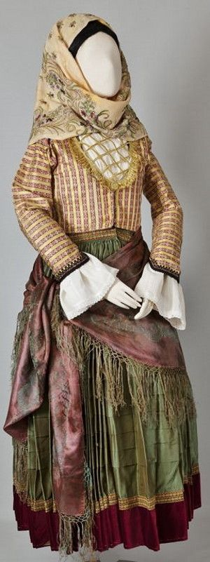 Women's costume of Spetses (Argosaronic Islands). Early 20th century.  The costumes of Spetses, Hydra and the Ermionida region generally used to have a pleated green dress with a crimson velvet hem and a zipoúni of brocade imported from Western Europe or the East. (©Peloponnesian Folklore Foundation, Nafplion).