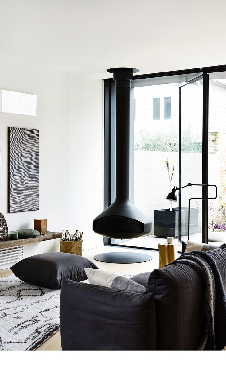 """The Ergo Focus suspended fireplace from [Oblica](http://www.oblica.com.au?utm_campaign=supplier/ target=""""_blank"""") is the focal point in the rear extension's living room.: [object Object]"""