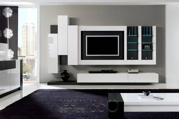 Entertainment center with floating cabinets but with symmetrical shelves for the sides home is for Floating wall units for living room