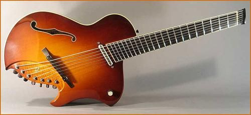 Fan-fret headless archtop. Very interesting looking guitar. #oneofakind #guitar #music
