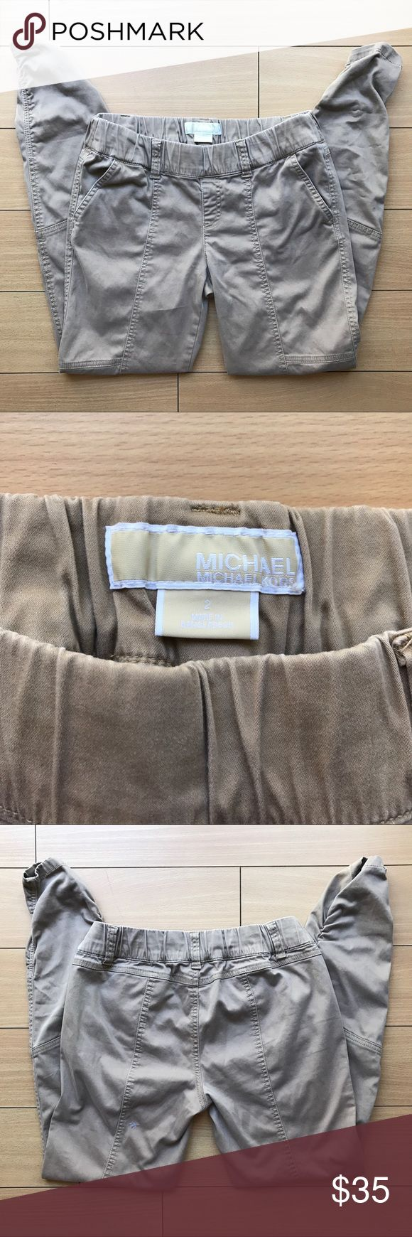 Michael Kors Ruched Ankle Slim Fit Joggers sz 2 Michael Kors joggers, size 2. Khaki in color. Elastic waistband with belt loops (does not come with belt). Ruched ankle detail. Slim fit style. EUC - no visible flaws. These are the perfect travel pants - casual and comfy!  Approx measurements laid flat:  waist: 14.5 front rise: 8.25 inseam: 27 Michael Kors Pants Track Pants & Joggers