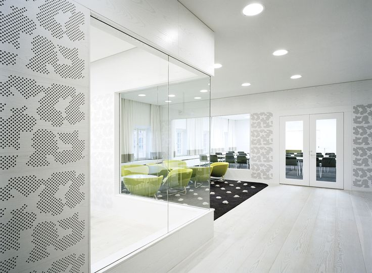 Acoustic wooden panels. The Swedish Association of Architects, Stockholm. Perforated white stained panels in the conference area - Gustafs.com
