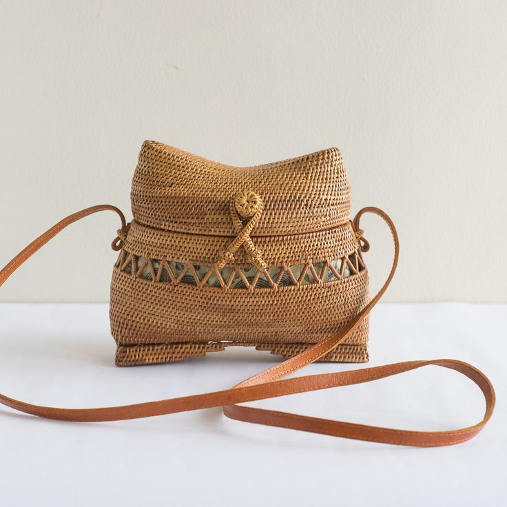 This unique, handmade rattan bag features a fisherman bag and is large enough to hold your mobile phone, a wallet, sunglasses, makeup kit, keys, and more.