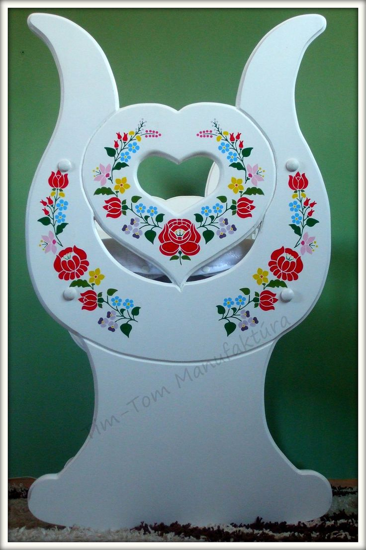 "Just finished the latest cradle. Among them their is one of the ""Heart"" fancy name. Outside the special shape the decoration on it makes it unique. The decoration is used in the traditional Hungarian motifs, but their design is made by us. So it will be different for each pattern. The same pattern is not used once again, so every cradle is unique, ""one valuable piece"""