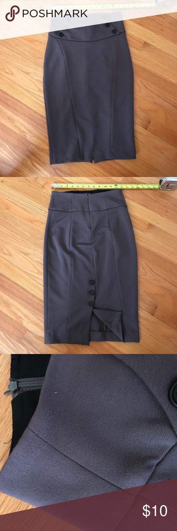 Zara taupe brown pencil skirt with button detail Gently used Zara basic taupe brown pencil skirt with cute button detail at the waist and back slit. Size xs. There is some very minor pilling at the right hip. Zara Skirts Pencil