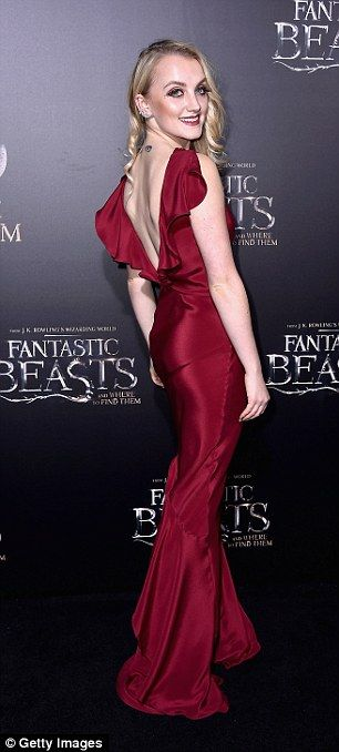 Red hot! Harry Potter actress Evanna Lynch, 25, smouldered in a figure-hugging deep burgundy gown