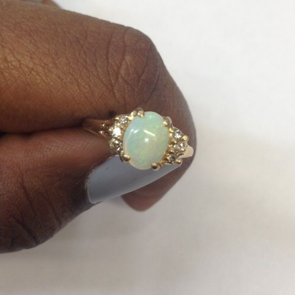 Gold Diamond Mother Of Pearl Ring 100% guaranteed real 10 karat gold, mother of pearl stone and diamonds. There are 3 diamonds on each side of the mother of pearl. Price is very firm! Jewelry Rings