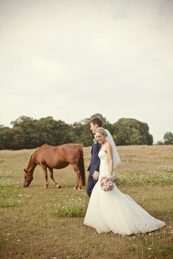 Lovely picture with a horse in the back ground. Looks like a wedding but with horse in background LOL