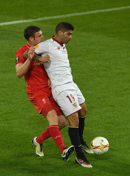 Ever Banega Photos Photos - Ever Banega of Sevilla and James Milner of Liverpool compete for the ball during the UEFA Europa League Final match between Liverpool and Sevilla at St. Jakob-Park on May 18, 2016 in Basel, Switzerland. - Liverpool v Sevilla - UEFA Europa League Final