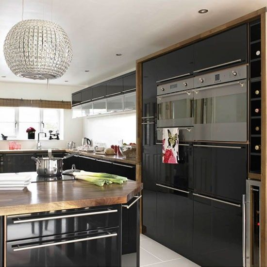 Black gloss floor to ceiling cabinets with oak surround - stainless steel detailing - Butler's Pantry