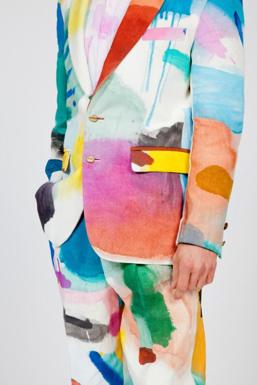 KOSTÜME DER ARMEN.  Sjim Hendrix wearing a suit made by his mom with fabric painted by Bonno van Doorn.