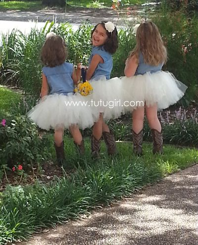 Flower girls wedding pic with a cute dress and cowboy boots