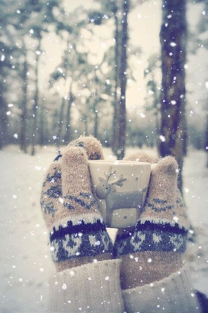 Mittens, snow and hot drinks