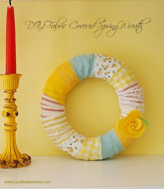 Easy Spring Wreath! This is a great project that uses up those little scraps of fabric leftover from other projects. Super easy to make and allows you to re-use your wreath form when you're tired of this look.| DIY Fabric Wrapped Wreath