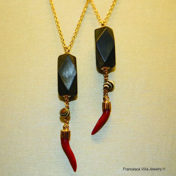 These My Lucky Day necklaces in gold and red coral have a vintage black horn bead and a lovely black/white little shell