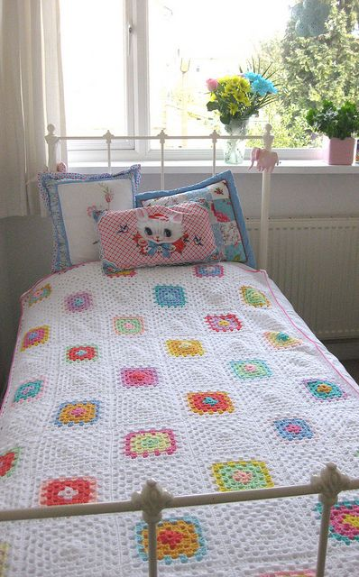 Sweet Granny Crochet Blanket. Love the alternating white squares that keep it from being too busy.
