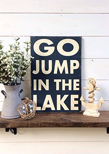 """Go Jump In The Lake Wood Sign Lake Sign Lake decor Lake house sign lake house decor. 16"""" x 24"""" with a framed back It is dark blue with white letters It hangs from a framed ledge back so no hanging hardware is needed Our signs are rustic hand painted and distressed so there will be imperfections and no 2 will be alike."""