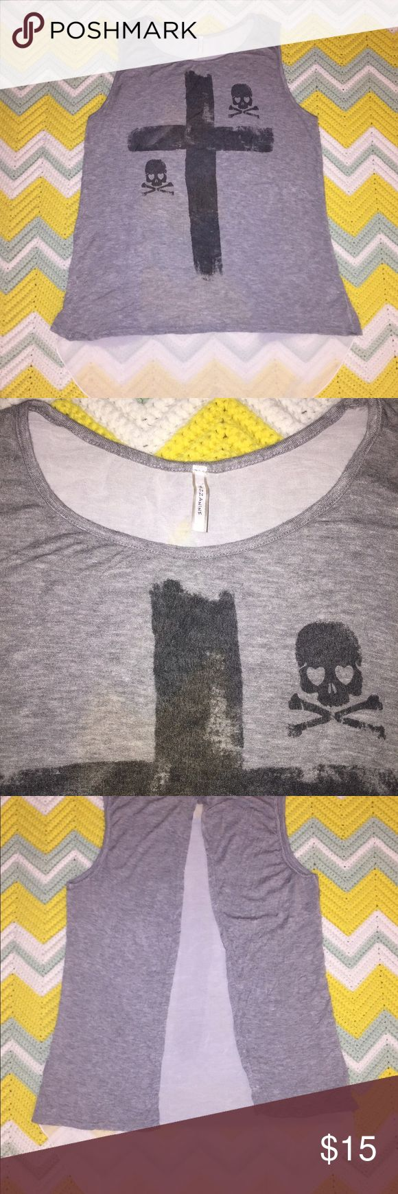 "Hi Low Skull 💀 💀 cross ✝️ semi-sheer top Item Condition: Excellent condition! Gently used with no flaws. No visible holes, stains, or tears! Color: gray with white sheer back Size: Large Measurements: (All measurements taken with garment lying flat are approximate) Chest (pit to pit): 19"" Length (top of collar to hem): 26"" front / 32.5"" back All items are from a smoke free and pet free home Tops Blouses"