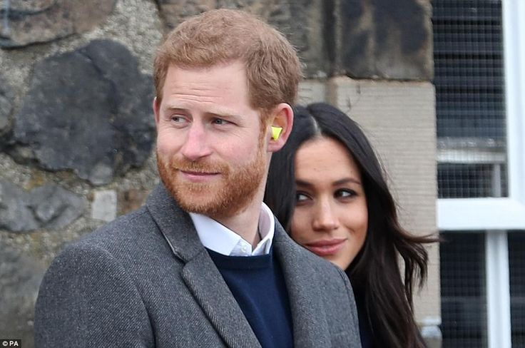 The couple were given ear defenders at Edinburgh Castle before standing behind the gun whi...