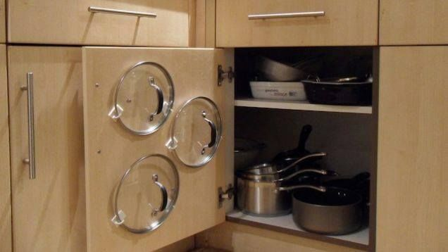 Savings Tip: Kitchen space saver: use command hooks to hold & organize pot lids.