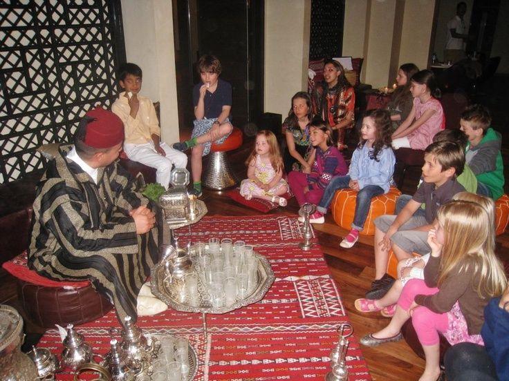 Abdelaziz the tea man shows kids how to make a Moroccan traditional mint tea