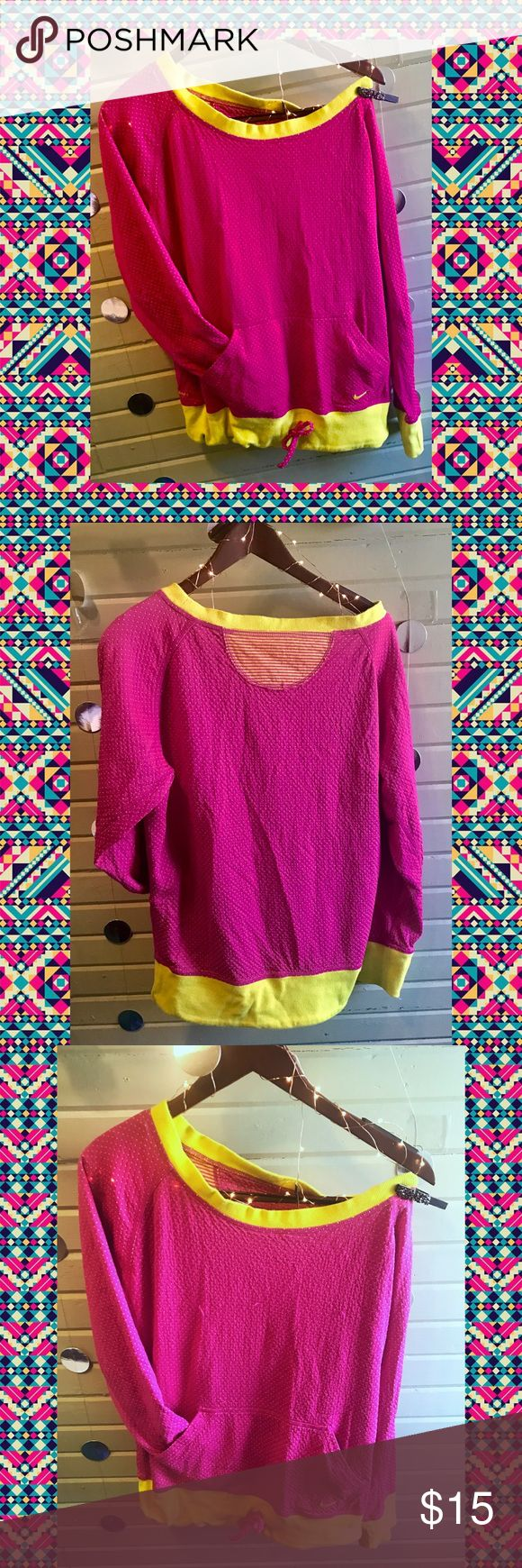 Nike Neon Pink & Yellow Slouchy Sweatshirt Fun and funky neon pink and yellow Slouchy off the shoulder style sweatshirt with a drawstring waistband. Hot neon pink textured material covered in yellow polka dots makes up most of this comfy cool Pullover. To add to the fun, it has wide neon yellow arm cuffs and waistband, which has a contrasting pink drawstring so you can customize your look. Worn off the shoulder or not, this look is comfy cool. Item is in GUC with some slight pilling.   Be…